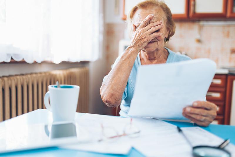 Elderlywomanlookingatherutilitybills.jpg