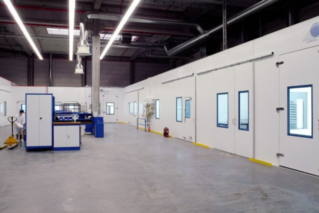 Overview of a total coating plant with different spray rooms and drying ovens