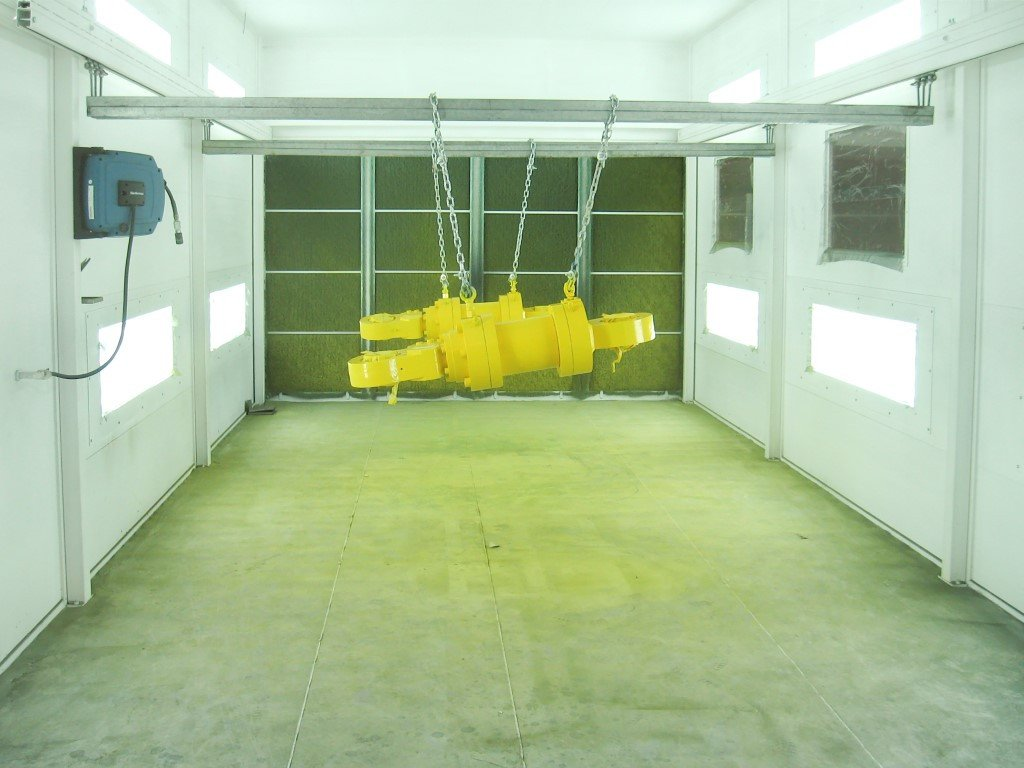 Dry filter spray booth with suspension brackets to hang on metal parts