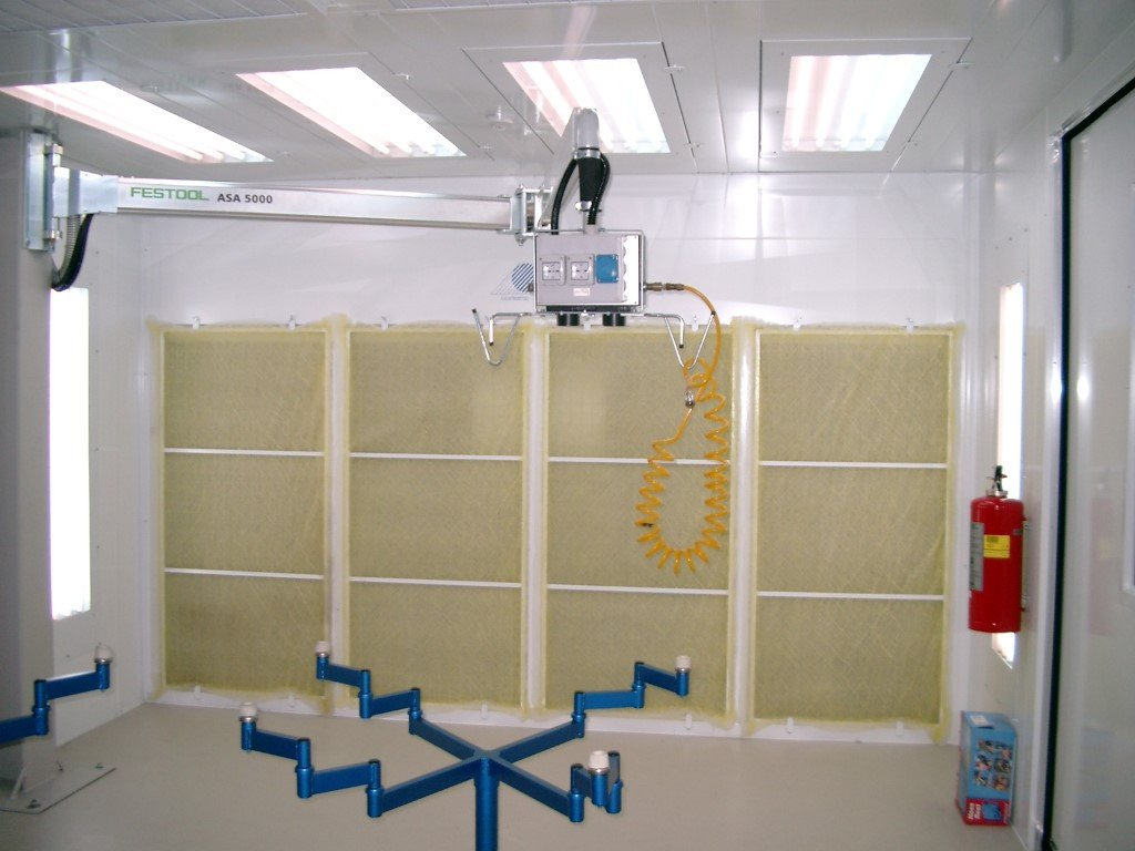Dust control booth for wood working industry