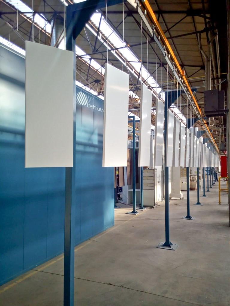 Coating line with powered overhead conveyor