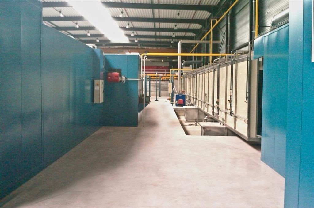 Painting line: right-hand side spray tunnel and continuous drying oven and left-hand side a powder cure oven
