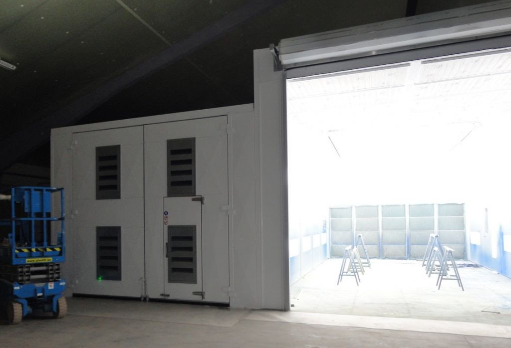 Shot blasting booth next to wet spray painting booth