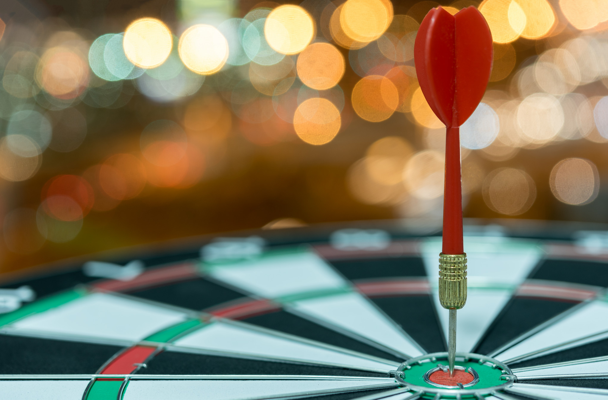 dart-target-arrow-bullseye-bokeh-background