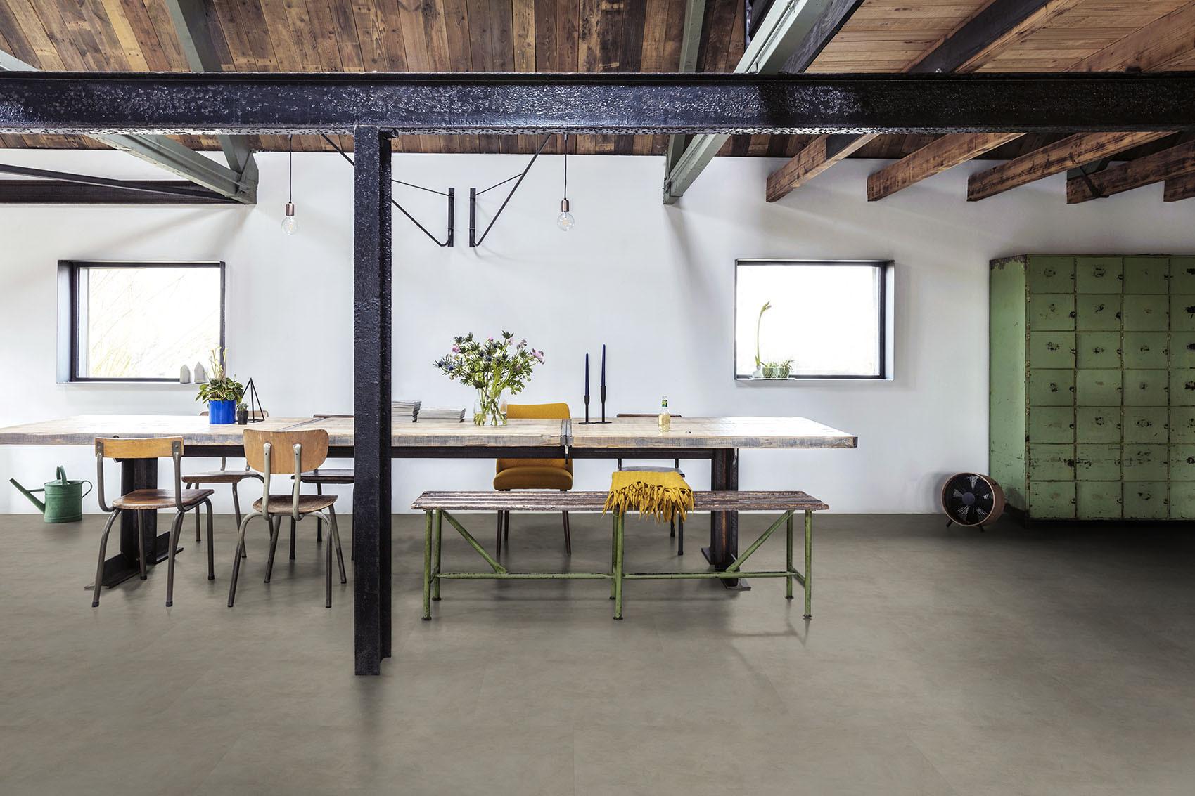 De natuurlijke look van betonvloer met het gemak van pvc