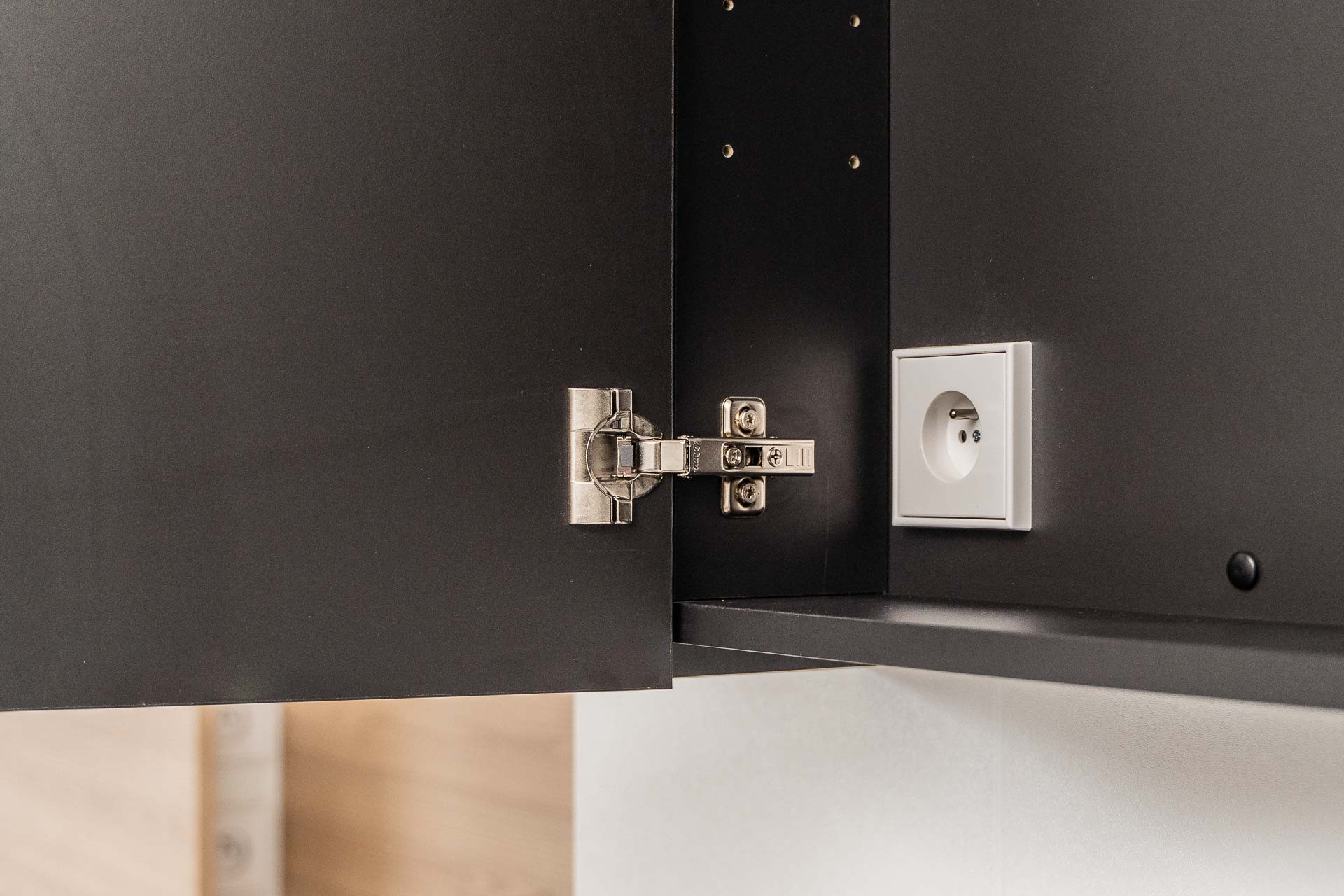 Mirror cabinet with electric socket