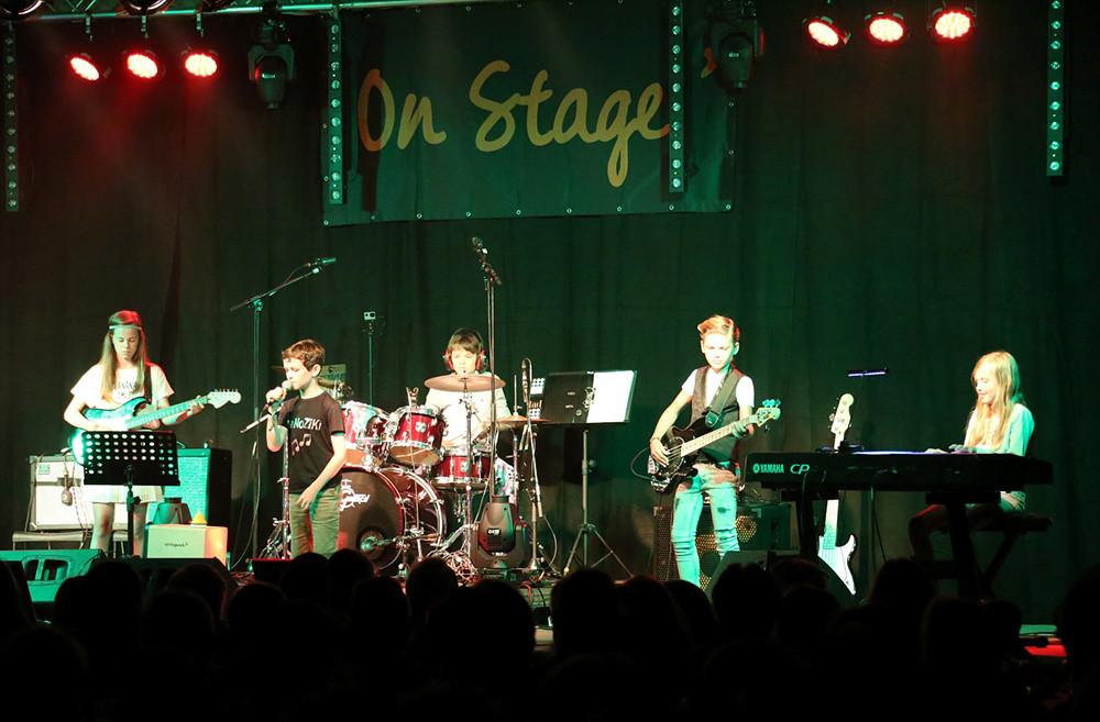 Bandcoaching 8, band on stage, muziek, muziekhuis, popmuziek muziekschool